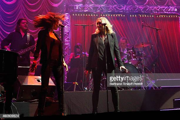 Chorus Singer Salome Stevenin and Christaline performs during the Laurent Gerra Show at Palais des Sports on December 27 2014 in Paris France