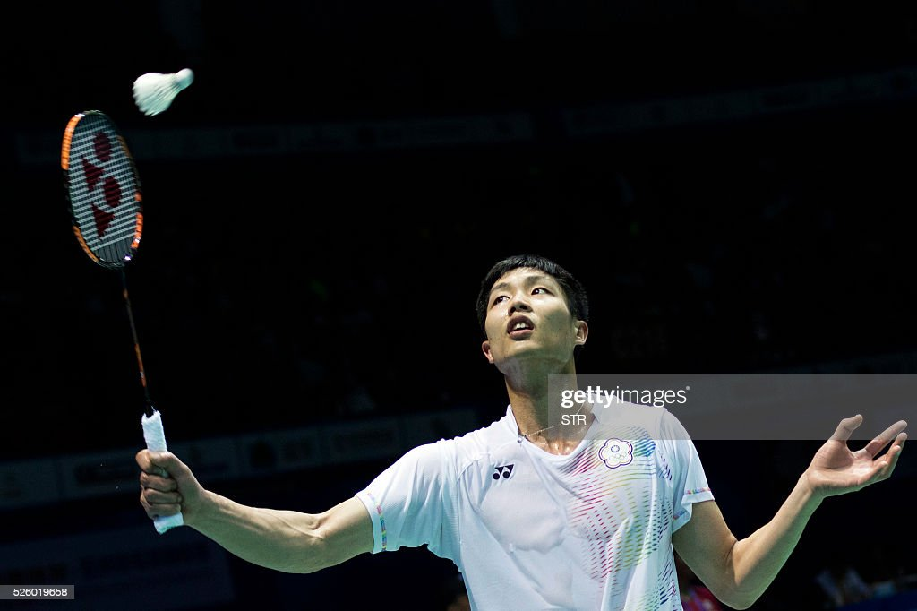 Chou Tien Chen of Taipei hits a return against Lee Chong Wei of Malaysia during their men's singles quarter-final match at the 2016 Badminton Asia Championships in Wuhan, central China's Hubei province on April 29, 2016. / AFP / STR