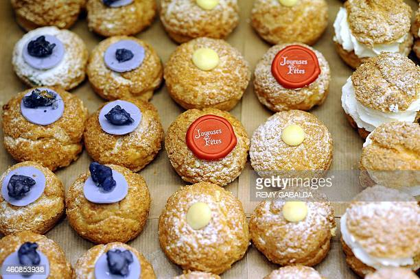 Choux buns are seen for sale on a stall at the Victor Hugo market in downtown Toulouse on December 27 2014 AFP PHOTO / REMY GABALDA