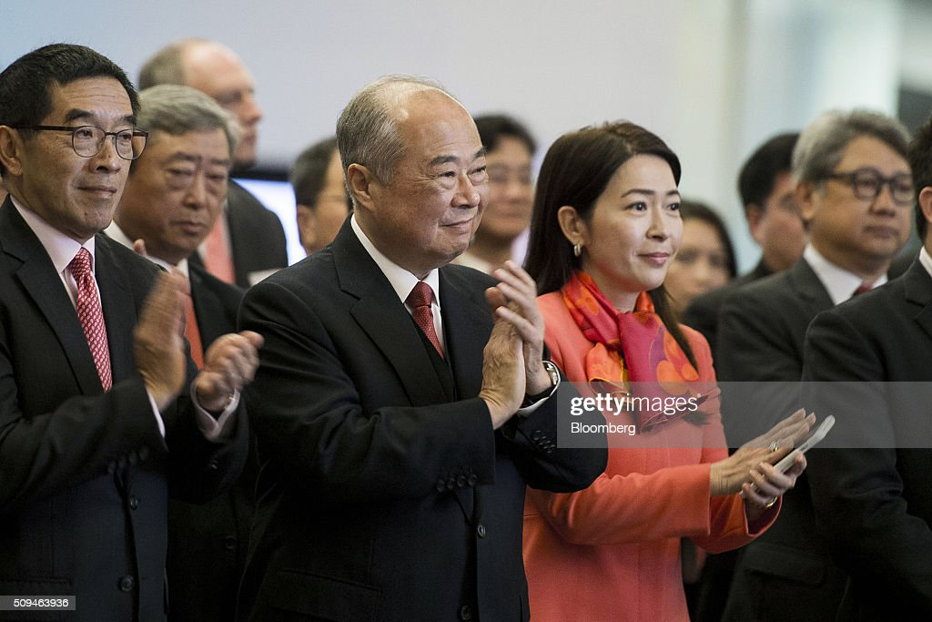 Chow Chung-Kong, chairman of Hong Kong Exchanges & Clearing Ltd. (HKEx), center, applauds a speech delivered on the first day of trading after lunar new year at the bourse in Hong Kong, China, on Thursday, Feb. 11, 2016. Hong Kong stocks headed for their worst start to a lunar new year since 1994 as a global equity rout deepened amid concern over the strength of the world economy. Photographer: Xaume Olleros/Bloomberg via Getty Images