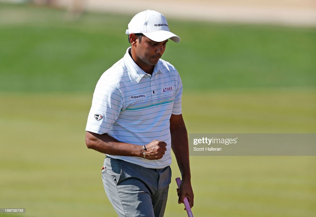 P. Chowrasia of India celebrates a birdie putt on the 18th green to finish with a seven-under par 65 during the third round of the Abu Dhabi HSBC Golf Championship at Abu Dhabi Golf Club on January 19, 2013 in Abu Dhabi, United Arab Emirates.
