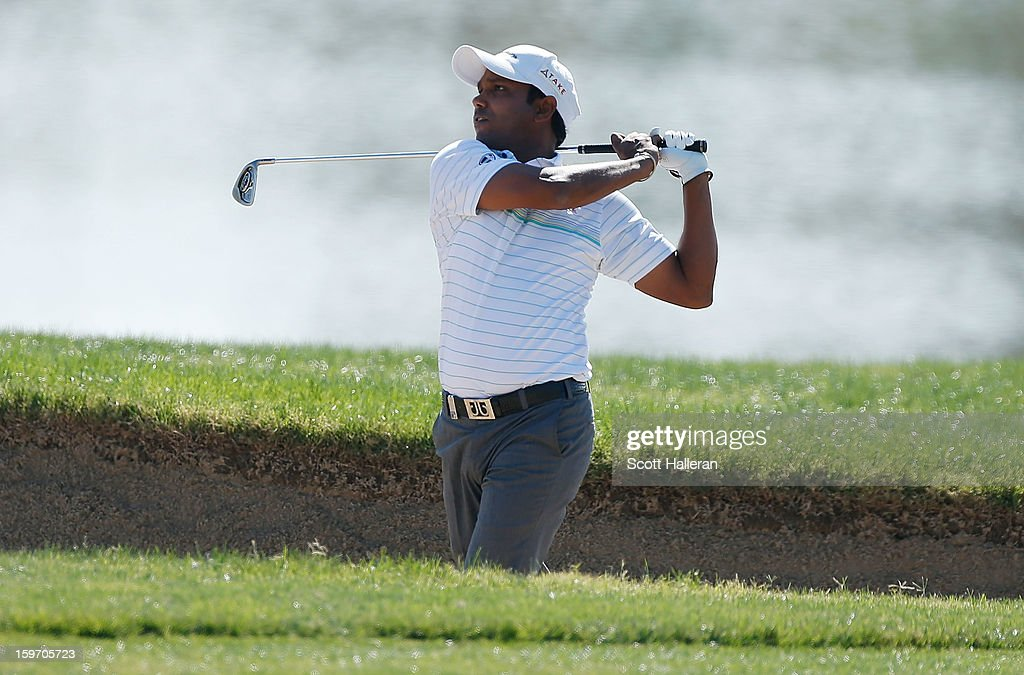 P. Chowrasia of India watches a shot on the 18th hole during the third round of the Abu Dhabi HSBC Golf Championship at Abu Dhabi Golf Club on January 19, 2013 in Abu Dhabi, United Arab Emirates.