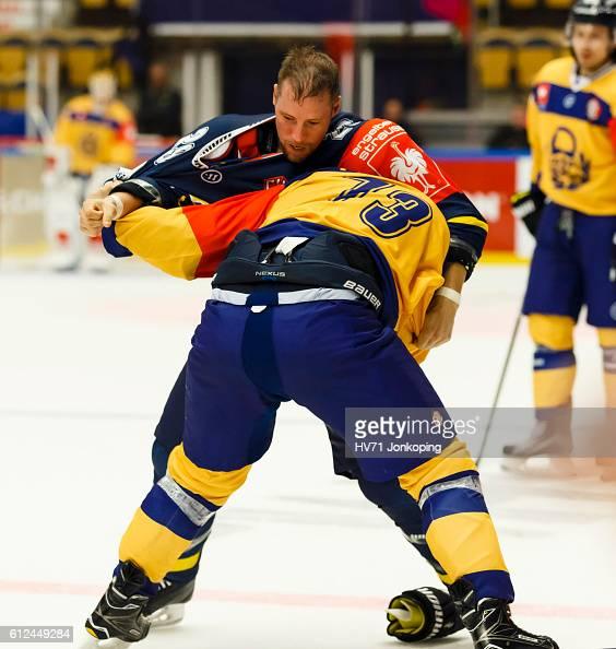 Chris Abbott of HV71 Jonkoping mixes it up with Ilmari Pitkanen of Lukko Rauma during the Champions Hockey League Round of 32 match between HV71...