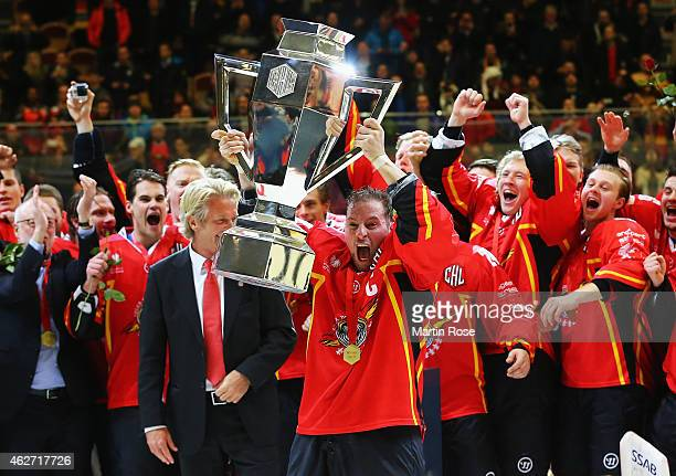 Chris Abbott of Lulea Hockey celebrates with the trophy after the Champions Hockey League Final match between Lulea Hockey and Frolunda Gothenburg at...