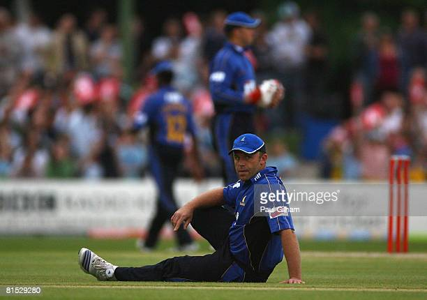 Chris Adams of Sussex Sharks looks on as Kent Spitfires hit a boundary during the Twenty20 Cup match between Kent and Sussex at St Lawrence Cricket...
