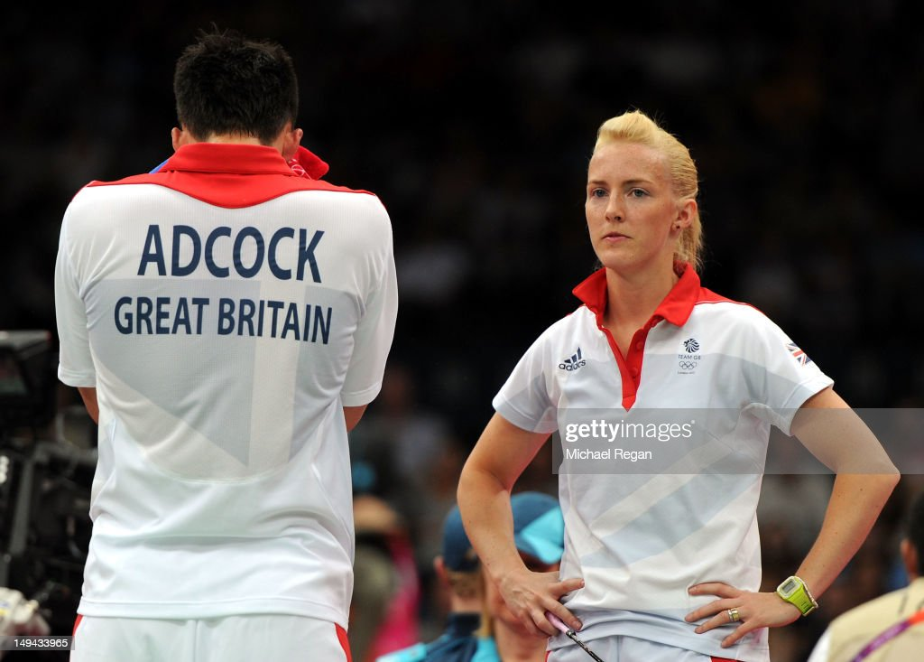 Chris Adcock (L) and Imogen Bankier (R) of Great Britain react after a play against Alexandr Nikolaenko and Valeria Sorokina of Russia during their Mixed Doubles Badminton on Day 1 of the London 2012 Olympic Games at Wembley Arena on July 28, 2012 in London, England.