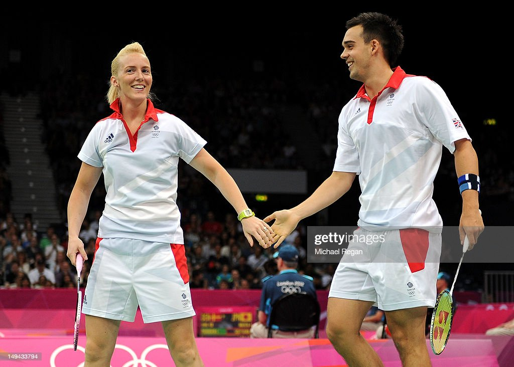 Chris Adcock (R) celebrates with teammate Imogen Bankier (L) of Great Britain after a play against Alexandr Nikolaenko and Valeria Sorokina of Russia during their Mixed Doubles Badminton on Day 1 of the London 2012 Olympic Games at Wembley Arena on July 28, 2012 in London, England.