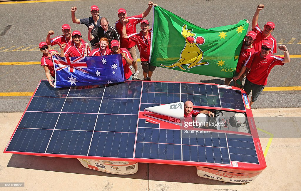 Chris Ahearn, driver of Arrow1 from Team Arrow, Associated with Queensland University of Technology in Australia along with team members pose after claiming provisional pole position in the Clipsal and Schneider Electric Challenger Class after Dynamic Scrutineering in the Bridgestone World Solar Challenge at the Hidden Valley Motor Sports Complex on October 5, 2013 in Darwin, Australia. Over 25 teams from accross the globe will compete in the 2013 World Solar Challenge - a 3000 km solar-powered vehicle race between Darwin and Adelaide. The race begins on October 6th with the first car expected to cross the finish line on October 10th.