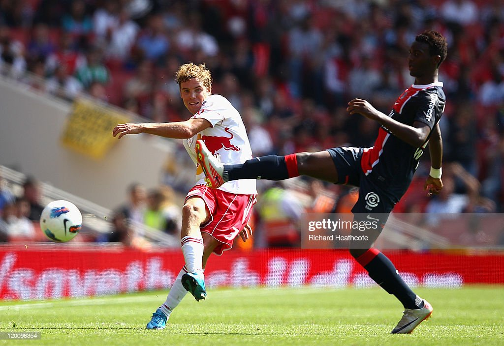 <a gi-track='captionPersonalityLinkClicked' href=/galleries/search?phrase=Chris+Albright&family=editorial&specificpeople=178253 ng-click='$event.stopPropagation()'>Chris Albright</a> of New York Red Bulls clears the ball ahead of the challenge by Jean Christophe Bahebeck of Paris St Germain during the Emirates Cup match between New York Red Bulls and Paris St Germain at the Emirates Stadium on July 30, 2011 in London, England.