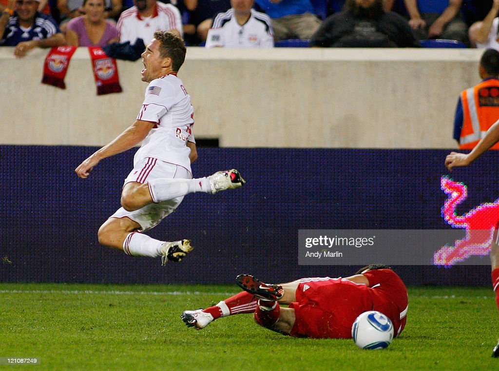 <a gi-track='captionPersonalityLinkClicked' href=/galleries/search?phrase=Chris+Albright&family=editorial&specificpeople=178253 ng-click='$event.stopPropagation()'>Chris Albright</a> #3 of the New York Red Bulls goes flying through the air after being tripped up by Sebastian Grazzini #10 of the Chicago Fire during the game at Red Bull Arena on August 13, 2011 in Harrison, New Jersey.