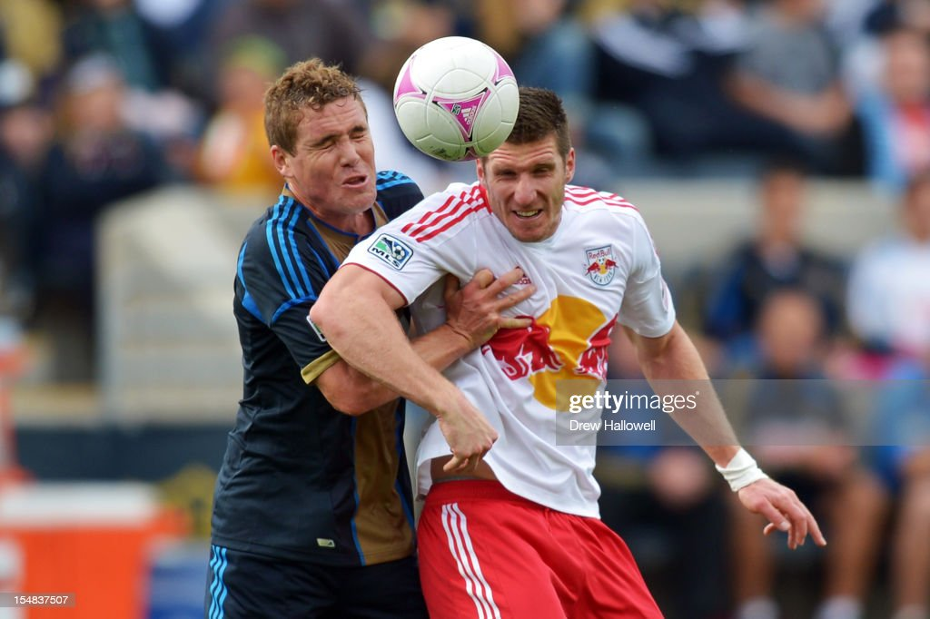 Chris Albright #3 of the Philadelphia Union and Kenny Cooper #33 of the New York Red Bulls try to head the ball at PPL Park on October 27, 2012 in Chester, Pennsylvania.