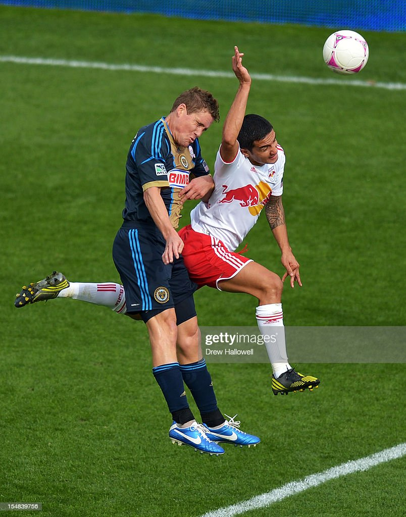 Chris Albright #3 of the Philadelphia Union and Tim Cahill #17 of the New York Red Bulls go up for the ball at PPL Park on October 27, 2012 in Chester, Pennsylvania. The Red Bulls won 3-0.