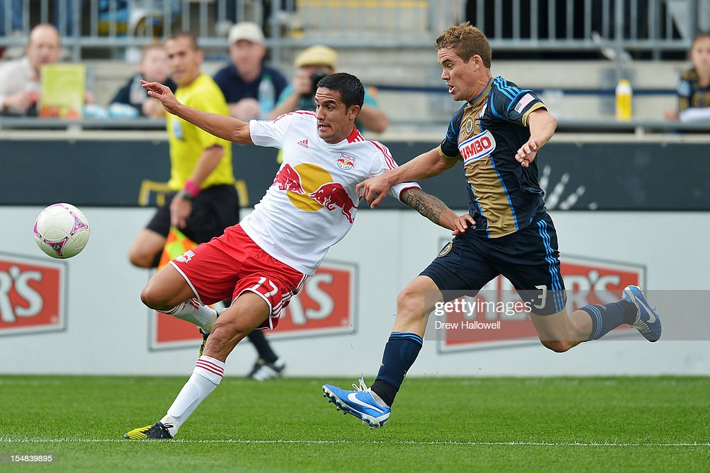 Chris Albright #3 of the Philadelphia Union and Tim Cahill #17 of the New York Red Bulls chase the ball at PPL Park on October 27, 2012 in Chester, Pennsylvania. The Red Bulls won 3-0.