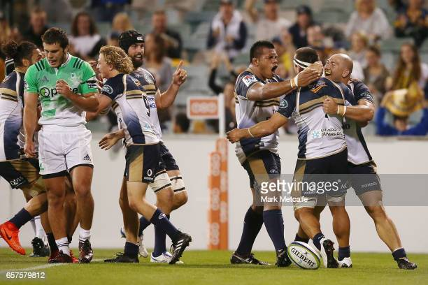 Chris Alcock of the Brumbies celebrates scoring a try with team mates during the round five Super Rugby match between the Brumbies and the...