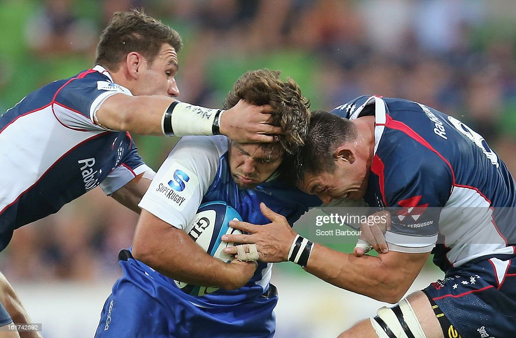 Chris Alcock of the Force is tackled during the round one Super Rugby match between the Rebels and the Force at AAMI Park on February 15, 2013 in Melbourne, Australia.