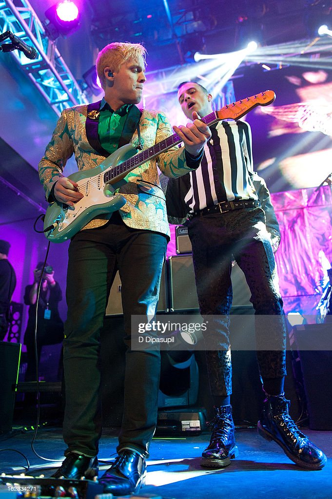 Chris Allen (L) and <a gi-track='captionPersonalityLinkClicked' href=/galleries/search?phrase=Tyler+Glenn&family=editorial&specificpeople=5680345 ng-click='$event.stopPropagation()'>Tyler Glenn</a> of Neon Trees perform on stage during The New Billboard 2013 launch event at Stage 48 on February 21, 2013 in New York City.