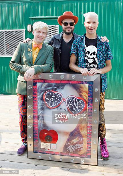 Chris Allen Branden Campbell and Tyler Glenn of Neon Trees pose backstage prior to a performance on ABC's 'Good Morning America' at Rumsey Playfield...