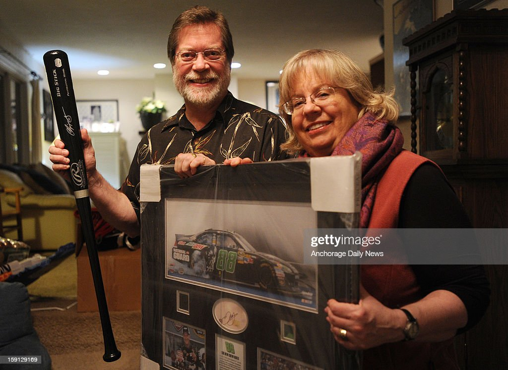 Chris and Susie Linford, right, pictured January 2, 2013, had their debt card hacked and thieves purchased $5,000 worth of stuff in an hour including this baseball bat signed by former Atlanta Braves third baseman Chipper Jones and a $900 Dale Earnhardt, Jr. signed print all of which were mistakenly shipped to their Anchorage home.