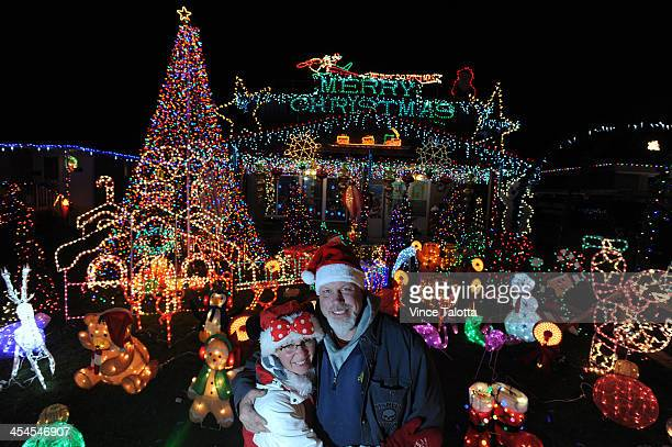TORONTO ON DECEMBER 6 Chris and Tammy Wright and family outside their home where visitors flock to see the Christmas lights each night in Pickering...