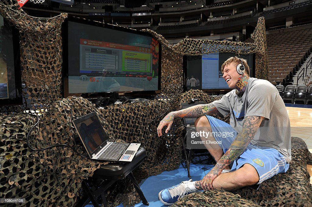 Chris Andersen #11 of the Denver Nuggets chats online with troops overseas in FOB Fenty Afghanistan as part of the Rehabbing with the Troops Wounded Warriors program on January 14, 2011 at the Pepsi Center in Denver, Colorado.