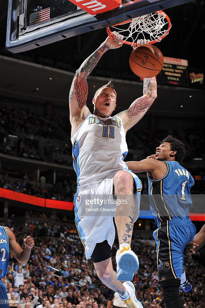 Chris Andersen #11 of the Denver Nuggets dunks the ball against Nick Young #1 of the Washington Wizards on March 25, 2011 at the Pepsi Center in Denver, Colorado.