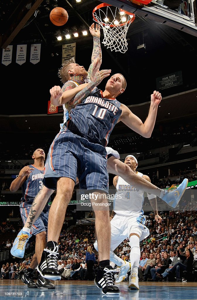 Chris Andersen of the Denver Nuggets is fouled by Joel Pryzbilla of the Charlotte Bobcats at the Pepsi Center on March 2 2011 in Denver Colorado NOTE...
