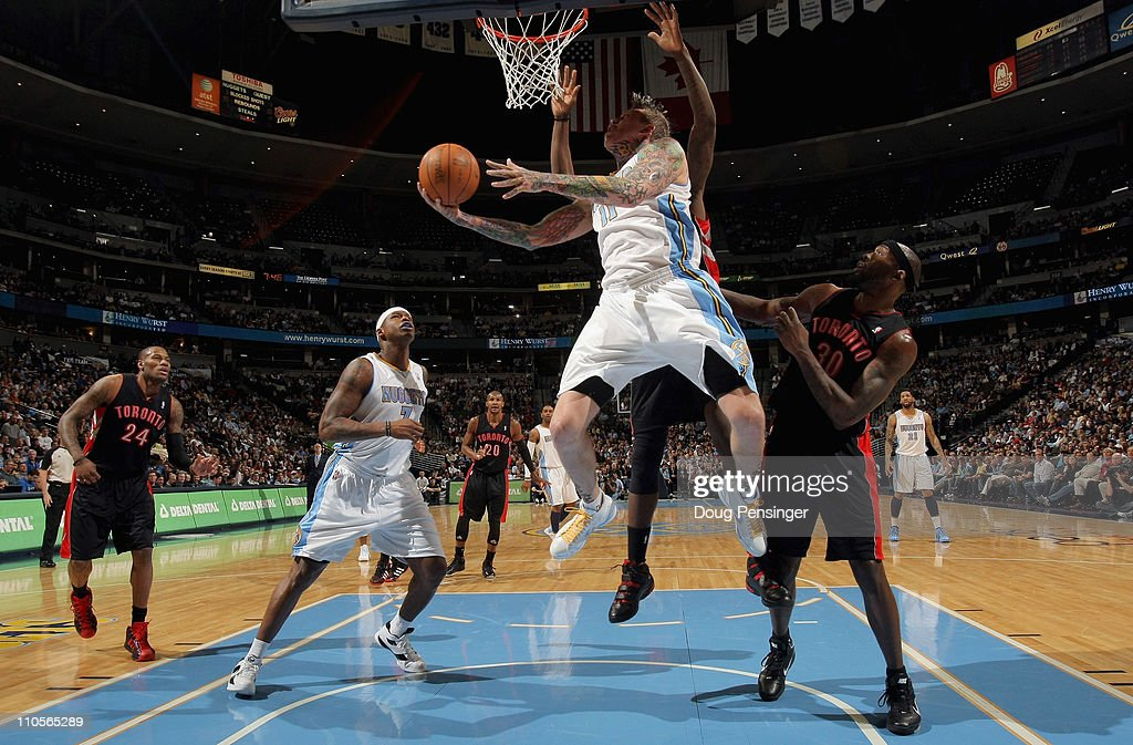 Chris Andersen #11 of the Denver Nuggets lays up a shot in front of <a gi-track='captionPersonalityLinkClicked' href=/galleries/search?phrase=Reggie+Evans&family=editorial&specificpeople=202254 ng-click='$event.stopPropagation()'>Reggie Evans</a> #30 of the Toronto Raptors at the Pepsi Center on March 21, 2011 in Denver, Colorado.