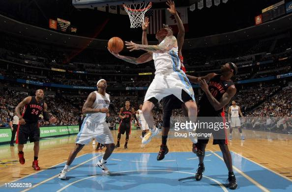Chris Andersen of the Denver Nuggets lays up a shot in front of Reggie Evans of the Toronto Raptors at the Pepsi Center on March 21 2011 in Denver...
