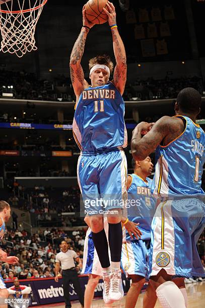 Chris Andersen of the Denver Nuggets pulls down a rebound against the Los Angeles Clippers at Staples Center on October 24 2008 in Los Angeles...