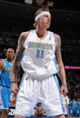 Chris Andersen of the Denver Nuggets reacts to a play against the New Orleans Hornets during Game Five of the Western Conference Quarterfinals during...