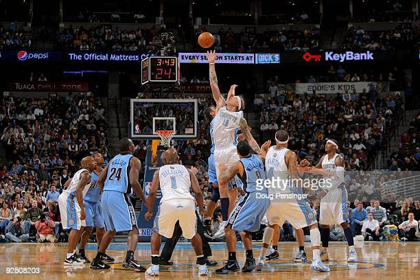 Chris Andersen of the Denver Nuggets wins a tip off against Mehmet Okur of the Utah Jazz during NBA action at Pepsi Center on October 28 2009 in...