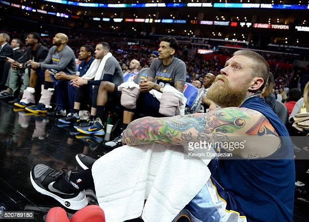 Chris Andersen of the Memphis Grizzlies and his teammates follow the game from the sideline during the second half of the basketball game at Staples...
