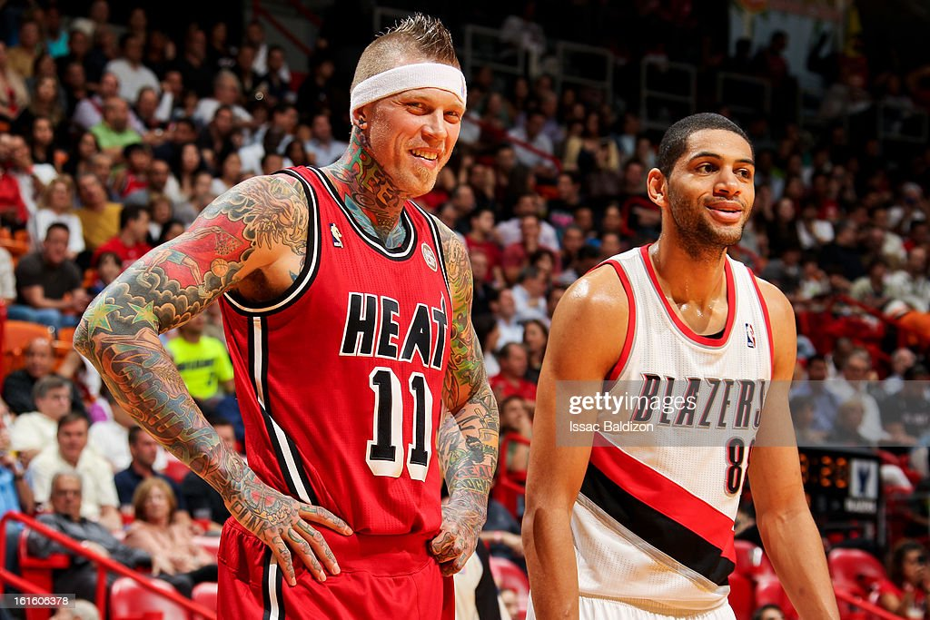 Chris Andersen #11 of the Miami Heat and Nicolas Batum #88 of the Portland Trail Blazers share a laugh during their game on February 12, 2013 at American Airlines Arena in Miami, Florida.