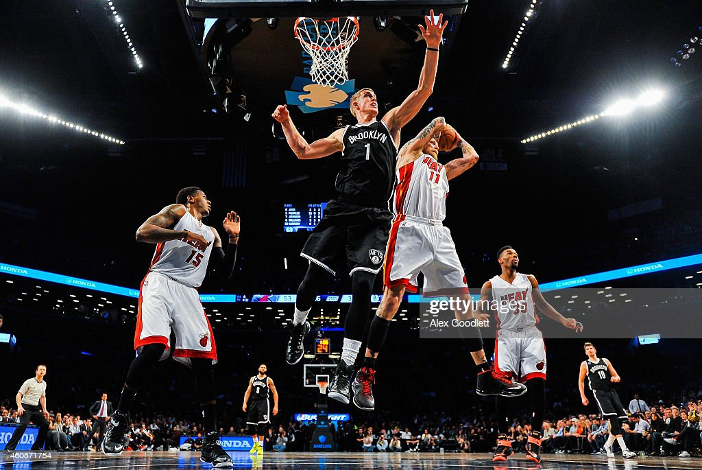 Chris Andersen #11 of the Miami Heat attempts a rebound with Mason Plumlee #1 of the Brooklyn Nets in the first half at the Barclays Center on December 16, 2014 in the Brooklyn Borough of New York City.