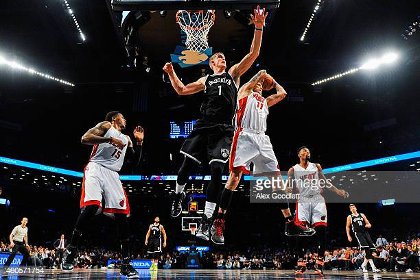 Chris Andersen of the Miami Heat attempts a rebound with Mason Plumlee of the Brooklyn Nets in the first half at the Barclays Center on December 16...