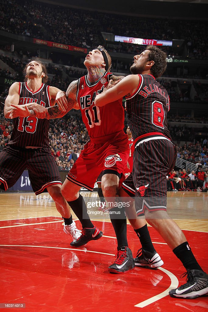 Chris Andersen #11 of the Miami Heat battles for rebound position against Joakim Noah #13 and Marco Belinelli #8 of the Chicago Bulls on February 21, 2013 at the United Center in Chicago, Illinois.
