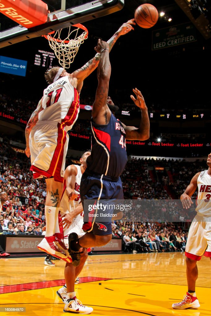 Chris Andersen #11 of the Miami Heat blocks a shot attempt by Ivan Johnson #44 of the Atlanta Hawks on March 12, 2013 at American Airlines Arena in Miami, Florida.