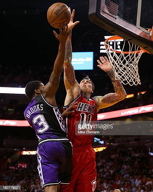 Chris Andersen of the Miami Heat blocks Aaron Brooks of the Sacramento Kings during a game at American Airlines Arena on February 26 2013 in Miami...