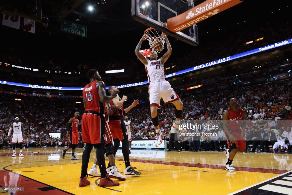 Chris Andersen #11 of the Miami Heat dunks the ball as <a gi-track='captionPersonalityLinkClicked' href=/galleries/search?phrase=Amir+Johnson&family=editorial&specificpeople=556786 ng-click='$event.stopPropagation()'>Amir Johnson</a> #15 of the Toronto Raptors looks on at American Airlines Arena on March 31, 2014 in Miami, Florida.