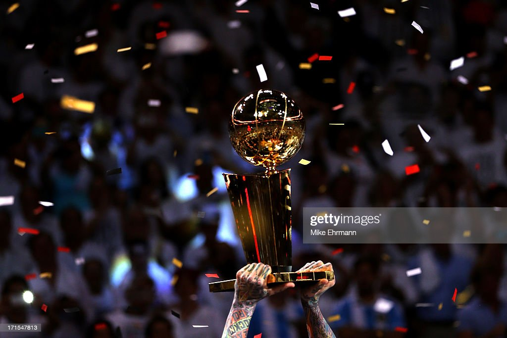 Chris Andersen of the Miami Heat holds up the Larry O'Brien Championship Trophy as the Heat celebrate after defeating the San Antonio Spurs 9588 to...