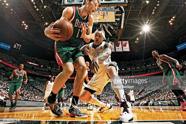Chris Andersen of the Miami Heat looks to push Mike Dunleavy of the Milwaukee Bucks in Game Two of the Eastern Conference Quarterfinals during the...