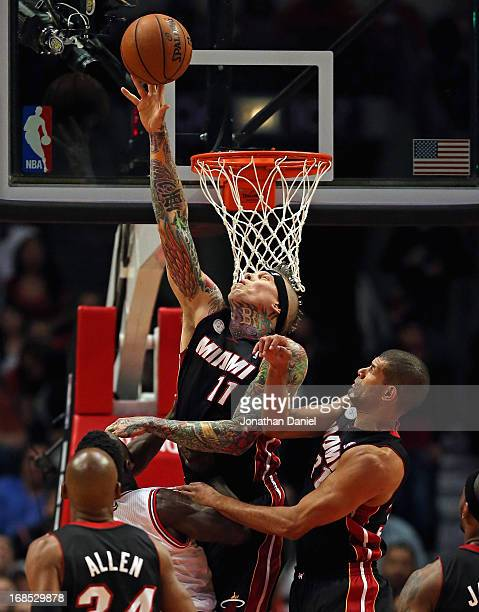 Chris Anderson of the Miami Heat blocks a shot by Nate Robinson of the Chicago Bulls in Game Three of the Eastern Conference Semifinals during the...