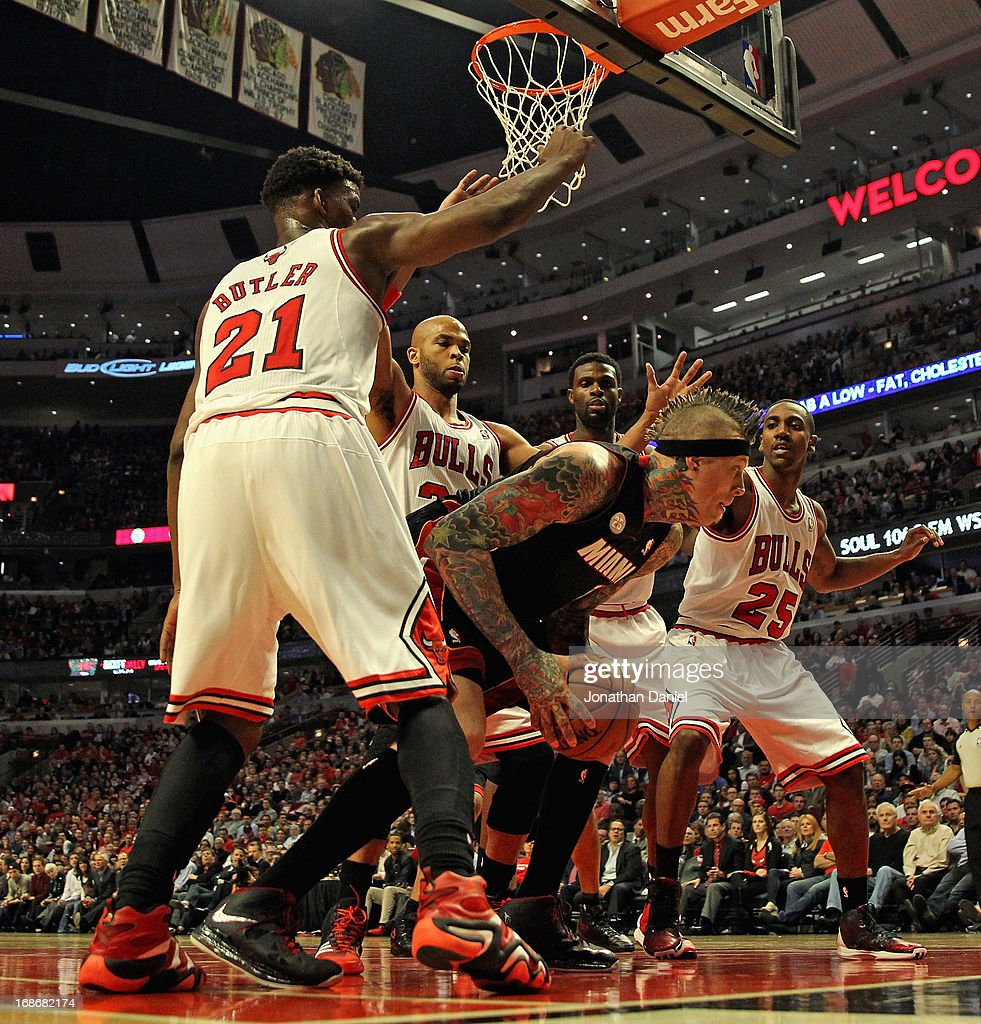 Chris Anderson #11 of the Miami Heat is surrounded by (L-R) Jimmy Butler #21, Taj Gibson #22, Nazr Mohammed #48 and Marquis Teague #25 of the Chicago Bulls in Game Four of the Eastern Conference Semifinals during the 2013 NBA Playoffs at the United Center on May 13, 2013 in Chicago, Illinois. The Heat defeated the Bulls 88-65.