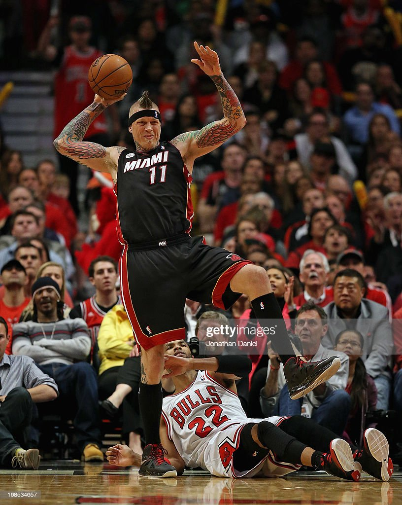 Chris Anderson #11 of the Miami Heat saves the ball from going out of bounds after being hit by <a gi-track='captionPersonalityLinkClicked' href=/galleries/search?phrase=Taj+Gibson&family=editorial&specificpeople=4029461 ng-click='$event.stopPropagation()'>Taj Gibson</a> #22 of the Chicago Bulls in Game Three of the Eastern Conference Semifinals during the 2013 NBA Playoffs at the United Center on May 10, 2013 in Chicago, Illinois. The Heat defeated the Bulls 104-94.