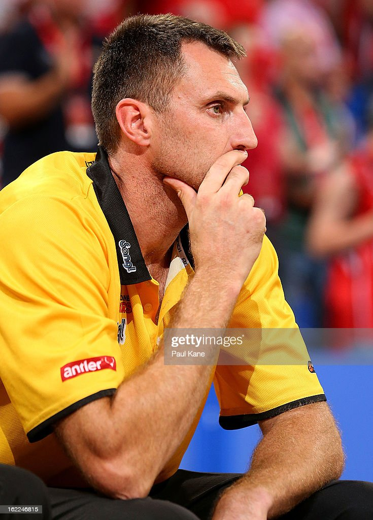Chris Anstey coach of the Tigers looks on from the bench during the round 20 NBL match between the Perth Wildcats and the Melbourne Tigers at Perth Arena on February 21, 2013 in Perth, Australia.