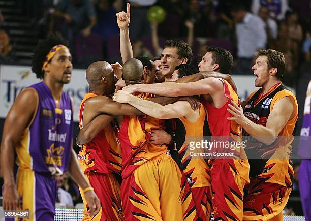 Chris Anstey of the Tigers celebrates with team mates after winning the NBL Championship after winning game three of the NBL grand final series...