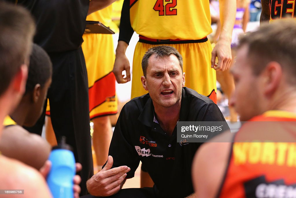 Chris Anstey the coach of the Tigers talks to his players during the round three NBL match between the Melbourne Tigers and the Adelaide 36ers at the State Netball Hockey Centre in October 27, 2013 in Melbourne, Australia.