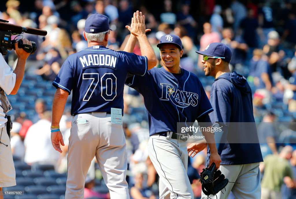 Chris Archer #22 of the Tampa Bay Rays celebrates his 1-0 complete game victory against the New York Yankees with manager <a gi-track='captionPersonalityLinkClicked' href=/galleries/search?phrase=Joe+Maddon&family=editorial&specificpeople=568433 ng-click='$event.stopPropagation()'>Joe Maddon</a> #70 and <a gi-track='captionPersonalityLinkClicked' href=/galleries/search?phrase=David+Price+-+Baseball+Player&family=editorial&specificpeople=4961936 ng-click='$event.stopPropagation()'>David Price</a> #14 at Yankee Stadium on July 27, 2013 in the Bronx borough of New York City.