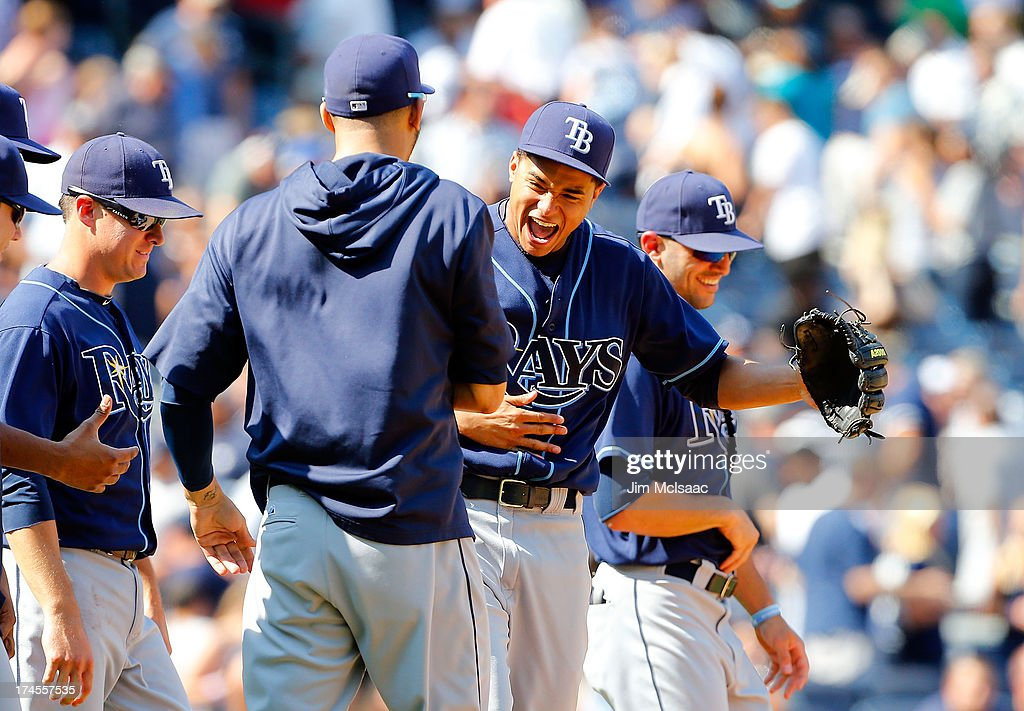 Chris Archer #22 of the Tampa Bay Rays celebrates his 1-0 complete game victory against the New York Yankees with teammate <a gi-track='captionPersonalityLinkClicked' href=/galleries/search?phrase=David+Price+-+Baseball+Player&family=editorial&specificpeople=4961936 ng-click='$event.stopPropagation()'>David Price</a> #14 at Yankee Stadium on July 27, 2013 in the Bronx borough of New York City.