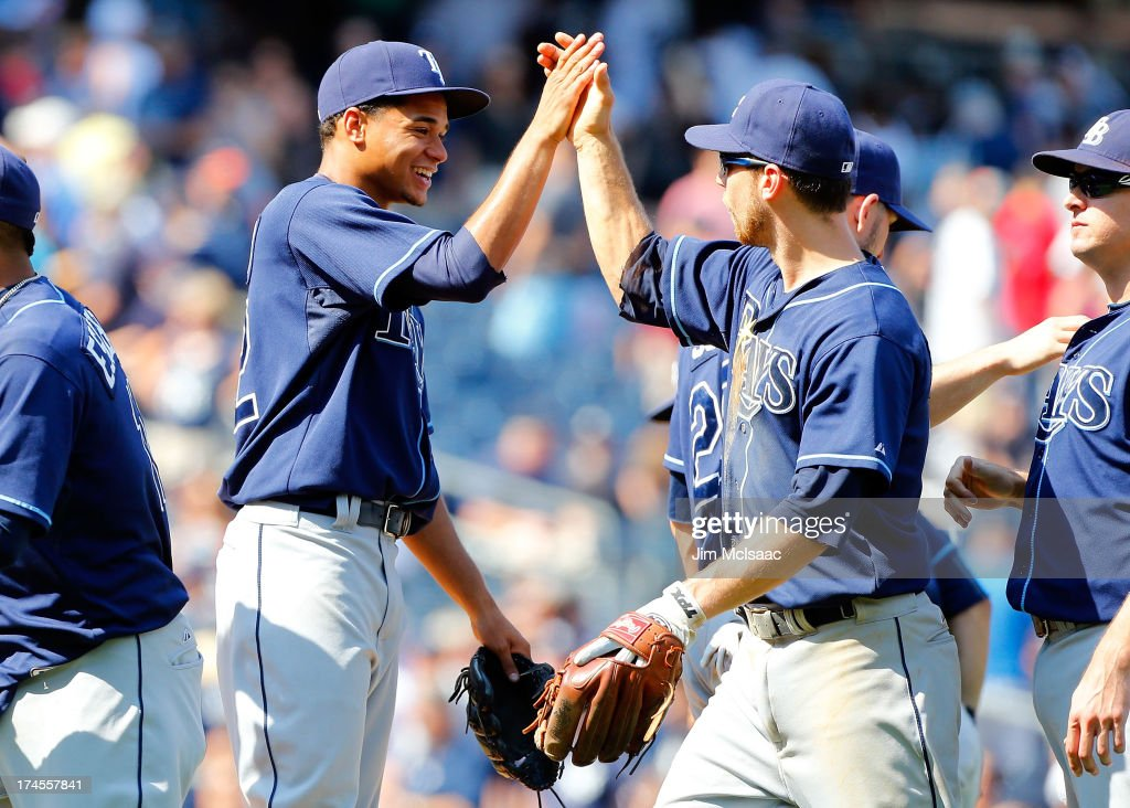 Chris Archer #22 of the Tampa Bay Rays celebrates his 1-0 complete game victory against the New York Yankees with teammate <a gi-track='captionPersonalityLinkClicked' href=/galleries/search?phrase=Ben+Zobrist&family=editorial&specificpeople=2120037 ng-click='$event.stopPropagation()'>Ben Zobrist</a> #18 at Yankee Stadium on July 27, 2013 in the Bronx borough of New York City.